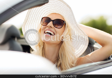 happy woman driving in cabriolet car stock photo, transport, leisure and people concept - face of happy woman in summer hat and sunglasses driving cabriolet car outdoors by Syda Productions