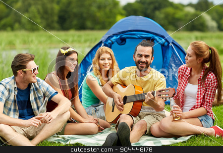 happy friends with drinks and guitar at camping stock photo, travel, tourism, hike, picnic and people concept - group of happy friends with tent and drinks playing guitar at camping by Syda Productions