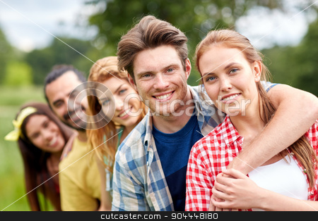 group of smiling friends outdoors stock photo, friendship, leisure, summer and people concept - group of smiling friends outdoors by Syda Productions