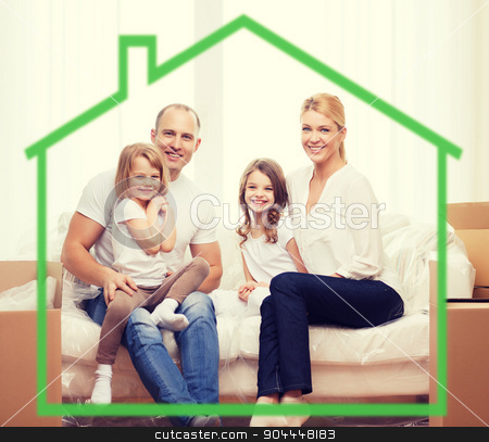 smiling parents and two little girls at new home stock photo, family, children, accommodation and home concept - smiling parents and two little girls at home behind green house symbol by Syda Productions