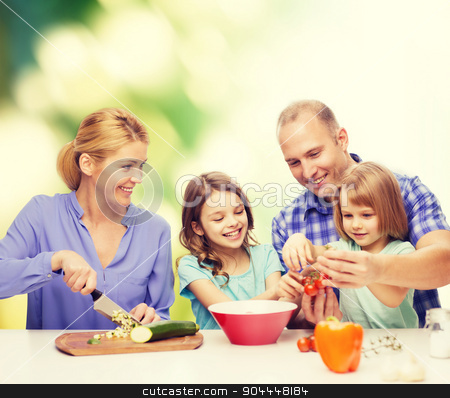 happy family with two kids making dinner at home stock photo, food, family, children, hapiness and people concept - happy family with two kids making dinner at home by Syda Productions