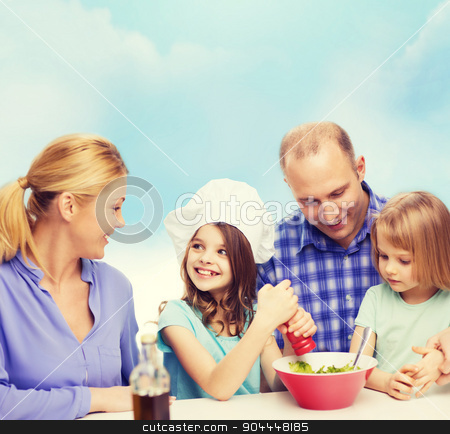 happy family with two kids eating at home stock photo, food, family, children, hapiness and people concept - happy family with two kids making dinner at home by Syda Productions