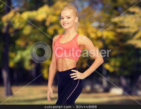 beautiful athletic woman in sportswear stock photo, fitness, sport and diet concept - beautiful athletic woman in sportswear by Syda Productions