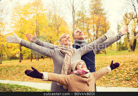 happy family having fun in autumn park stock photo, family, childhood, season and people concept - happy family having fun in autumn park by Syda Productions