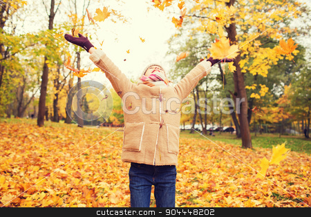 smiling little girl with autumn leaves in park stock photo, childhood, season and people concept - smiling little girl having fun in autumn park by Syda Productions