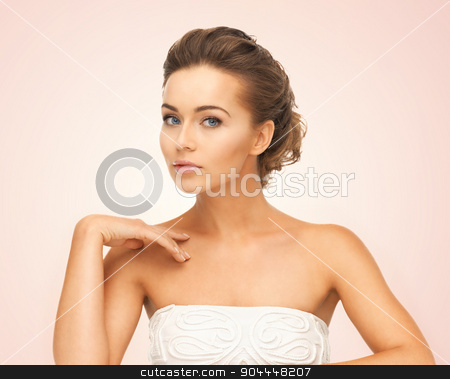 beautiful woman stock photo, close up of face and hands of beautiful young woman by Syda Productions