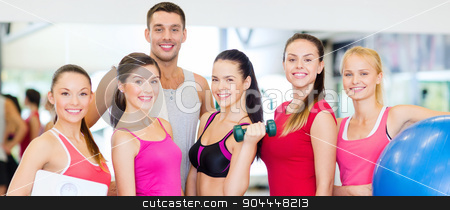 group of smiling people in the gym stock photo, fitness, sport, training, gym and lifestyle concept - group of smiling people in the gym by Syda Productions