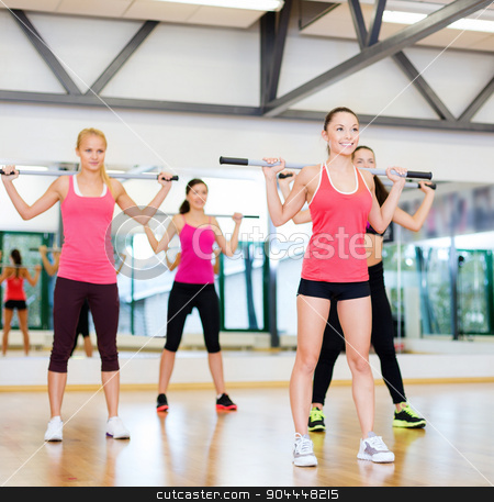 group of smiling people working out with barbells stock photo, fitness, sport, training, gym and lifestyle concept - group of smiling people working out with barbells in the gym by Syda Productions