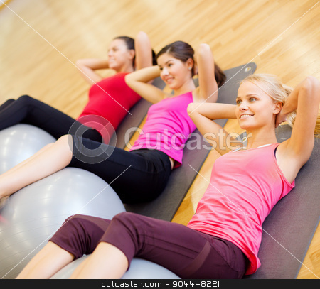group of people working out in pilates class stock photo, fitness, sport, training, gym and lifestyle concept - group of smiling people working out in pilates class by Syda Productions