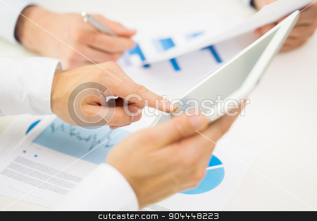 close up of businessman hands with tablet pc stock photo, business, people, technology and teamwork concept - close up of businessman hands with tablet pc computer blank screens at office by Syda Productions