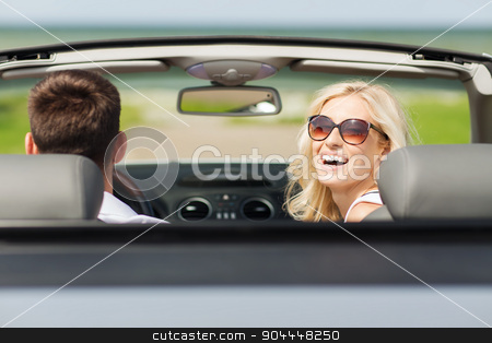 happy man and woman driving in cabriolet car stock photo, transport, road trip, leisure, couple and people concept - happy man and woman driving in cabriolet car outdoors by Syda Productions
