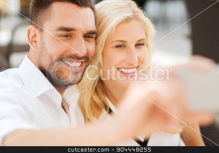 happy couple taking selfie with smatphone outdoors stock photo, love, date, technology, people and relations concept - smiling happy couple taking selfie with smatphone outdoors by Syda Productions