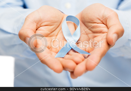 hands with blue prostate cancer awareness ribbon stock photo, medicine, health care, gesture and people concept - close up of male hands holding blue prostate cancer awareness ribbon by Syda Productions