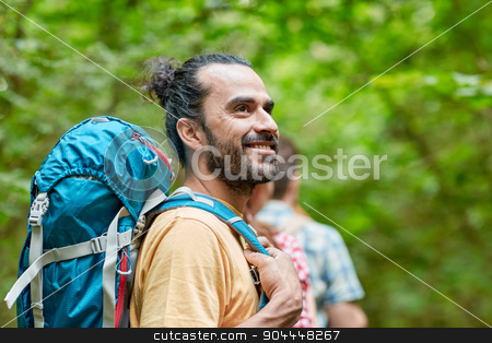 group of smiling friends with backpacks hiking stock photo, adventure, travel, tourism, hike and people concept - group of smiling friends walking with backpacks in woods by Syda Productions