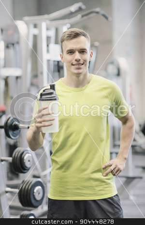 smiling man with protein shake bottle stock photo, sport, fitness, lifestyle and people concept - smiling man with protein shake bottle in gym by Syda Productions