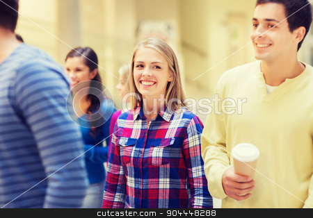 group of smiling students with paper coffee cups stock photo, education, high school, friendship, drinks and people concept - group of smiling students with paper coffee cups by Syda Productions