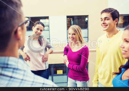 group of smiling students outdoors stock photo, friendship, people and education concept - group of smiling students outdoors by Syda Productions
