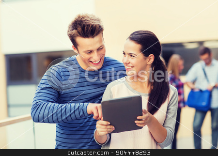 group of smiling students tablet pc computer stock photo, friendship, people, technology and education concept - group of smiling students with tablet pc computer outdoors by Syda Productions