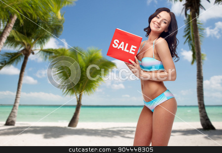happy woman in swimsuit with sale sign on beach stock photo, people, swimwear, summer shopping and travel concept - happy young woman in bikini swimsuit with red sale sign over tropical beach with palm trees background by Syda Productions