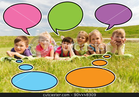 group of kids lying on blanket or cover outdoors stock photo, summer, childhood, leisure and people concept - group of happy kids lying on blanket or cover outdoors with colorful text bubble icons by Syda Productions