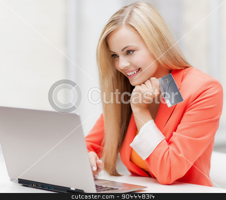 businesswoman with laptop and credit card stock photo, smiling businesswoman with laptop and credit card by Syda Productions