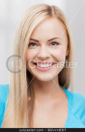 close up of woman stock photo, bright close up of smiling woman indoors by Syda Productions