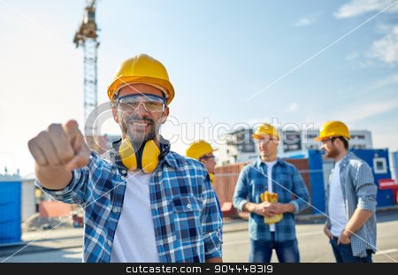 builders pointing finger at you on construction stock photo, business, building, teamwork and people concept - group of smiling builders in hardhats pointing finger at you on construction site by Syda Productions