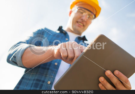 close up of builder in hardhat with tablet pc stock photo, business, building, industry, technology and people concept - close up of smiling builder in hardhat with tablet pc computer outdoors by Syda Productions