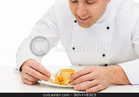 close up of happy male chef cook decorating dessert stock photo, cooking, profession, haute cuisine, food and people concept - close up of happy male chef cook decorating dessert by Syda Productions