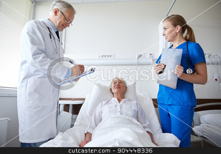 doctor and nurse visiting senior woman at hospital stock photo, medicine, age, health care and people concept - doctor and nurse with clipboards visiting senior patient woman at hospital ward by Syda Productions