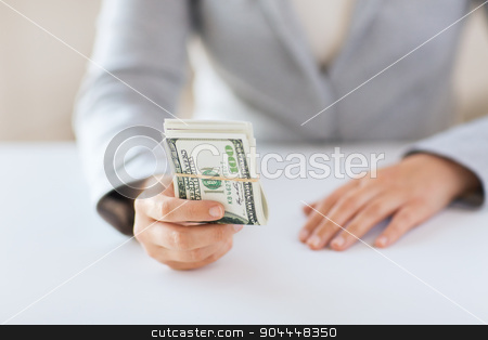 close up of woman hands holding us dollar money stock photo, business, finance, saving, banking and people concept - close up of woman hands holding us dollar money by Syda Productions