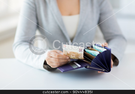 close up of woman hands with wallet and euro money stock photo, business, finance, saving, banking and people concept - close up of woman hands with wallet and euro money by Syda Productions