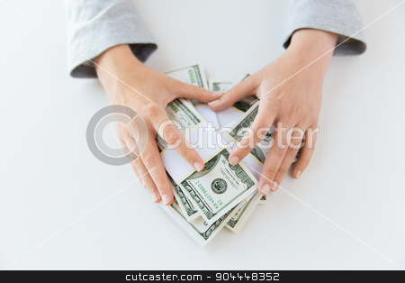 close up of woman hands counting us dollar money stock photo, business, finance, saving, banking and people concept - close up of woman hands counting us dollar money by Syda Productions