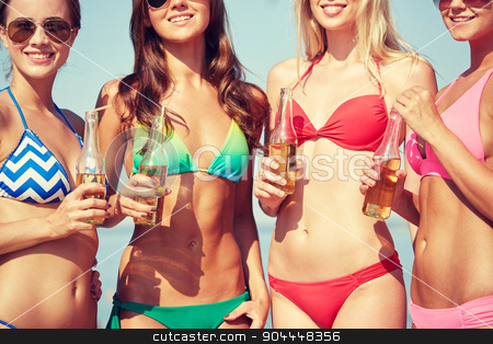 close up of young women drinking lemonade on beach stock photo, summer vacation, holidays, party, travel and people concept - close up of young women drinking lemonade on beach by Syda Productions