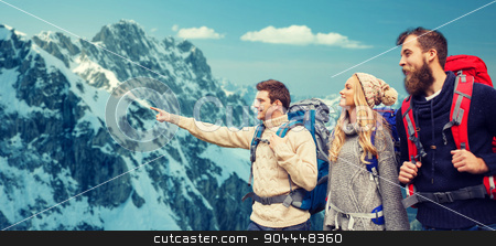 group of smiling friends with backpacks hiking stock photo, adventure, travel, tourism, hike and people concept - group of smiling friends with backpacks pointing finger over alpine mountains background by Syda Productions
