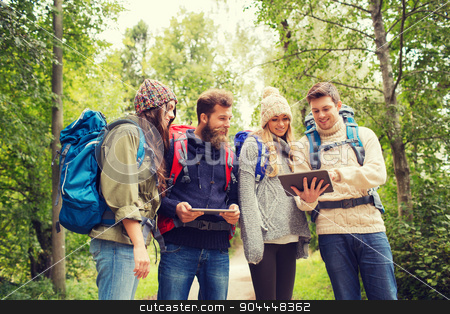 group of friends with backpacks and tablet pc stock photo, adventure, travel, tourism, hike and people concept - group of smiling friends with backpacks and tablet pc computers outdoors by Syda Productions