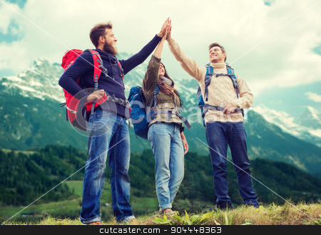 group of smiling friends with backpacks hiking stock photo, travel, tourism, hike, gesture and people concept - group of smiling friends with backpacks making high five over alpine mountains background by Syda Productions