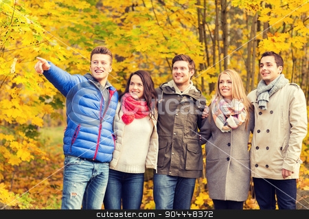 group of smiling men and women in autumn park stock photo, love, relationship, season, friendship and people concept - group of smiling men and women hugging in autumn park by Syda Productions