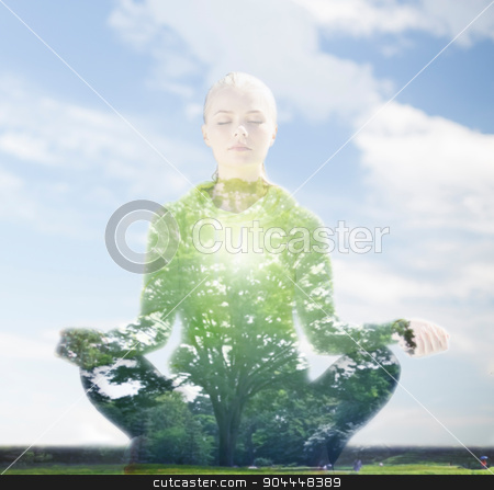 happy young woman doing yoga outdoors stock photo, sport, fitness, yoga, double exposure and people concept - happy young woman meditating in lotus pose over blue sky and green tree background by Syda Productions