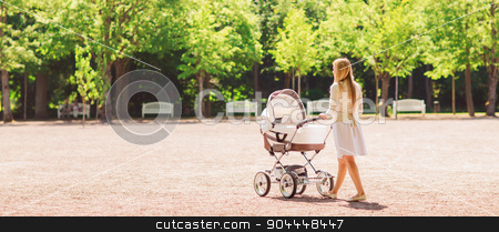 happy mother with stroller in park stock photo, family, child and parenthood concept - happy mother walking with baby stroller in park from back by Syda Productions