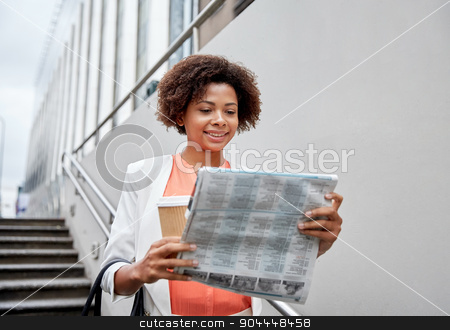 happy african businesswoman with coffee in city stock photo, business and people concept - young smiling african american businesswoman with coffee cup going down stairs into city underpass by Syda Productions