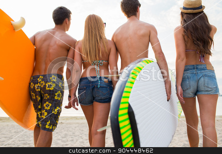 friends with surfboards on summer beach stock photo, friendship, sea, summer vacation, water sport and people concept - group of friends wearing swimwear with surfboards on beach from back by Syda Productions