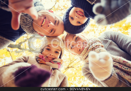 happy family in autumn park stock photo, family, childhood, season, gesture and people concept - happy family pointing finger on you in autumn park by Syda Productions