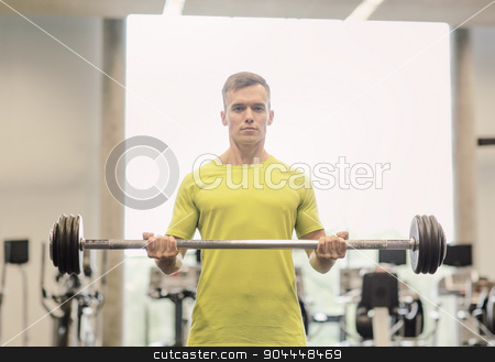 man doing exercise with barbell in gym stock photo, sport, fitness, lifestyle and people concept - man doing exercise with barbell in gym by Syda Productions