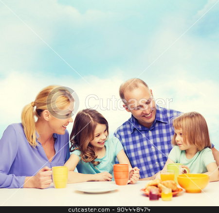 happy family with two kids with having breakfast stock photo, food, family, children, hapiness and people concept - happy family with two kids having breakfast at home by Syda Productions