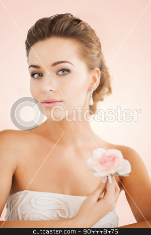 woman with diamond earrings stock photo, beautiful woman in white dress and diamond earrings by Syda Productions