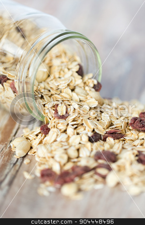 close up of jar with granola or muesli on table stock photo, food, healthy eating and diet concept - close up of jar with granola or muesli on table by Syda Productions