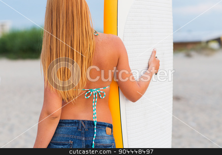 young woman with surfboard on beach stock photo, sea, summer vacation, water sport and people concept - woman with surfboard on beach from back by Syda Productions