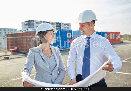 happy architects with blueprint at building stock photo, construction, architecture, business, teamwork and people concept - happy architects with blueprint at building site by Syda Productions