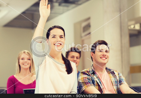 group of smiling students in lecture hall stock photo, education, high school, teamwork and people concept - group of smiling students raising hand in lecture hall by Syda Productions